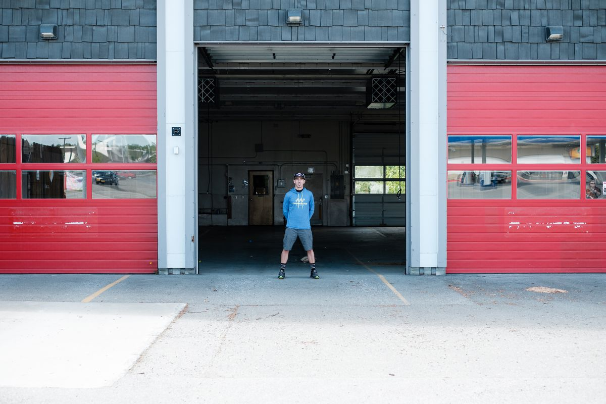 James Stull, owner of Chain Reaction Cycles, stands Friday in the garage entryway of his new building, which he hopes to have renovated and running as a storefront by September of this year. Stull purchased the fire station from the municipality for $1.2 million. (Young Kim / Alaska Dispatch News)