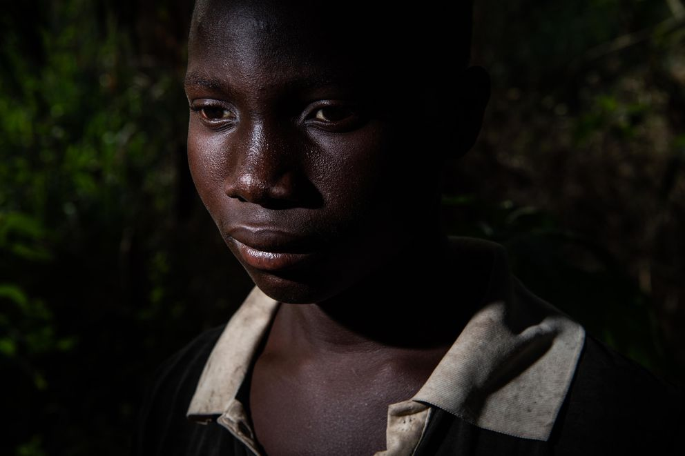 Abou Ouedrago, 15, from Burkina Faso, is like many teen boys on the cocoa farms who sleep in huts out in the woods, spend their days doing hard manual labor and don't attend school or see their families. (Washington Post photo by Salwan Georges.)