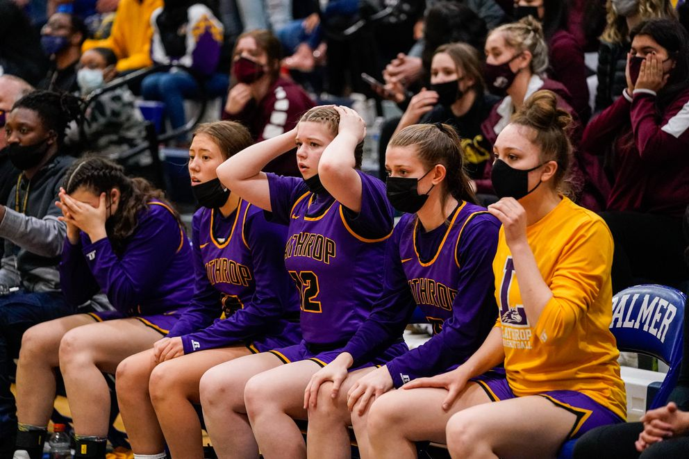 Lathrop girls react to a free throw attempt late in the game. (Loren Holmes / ADN)