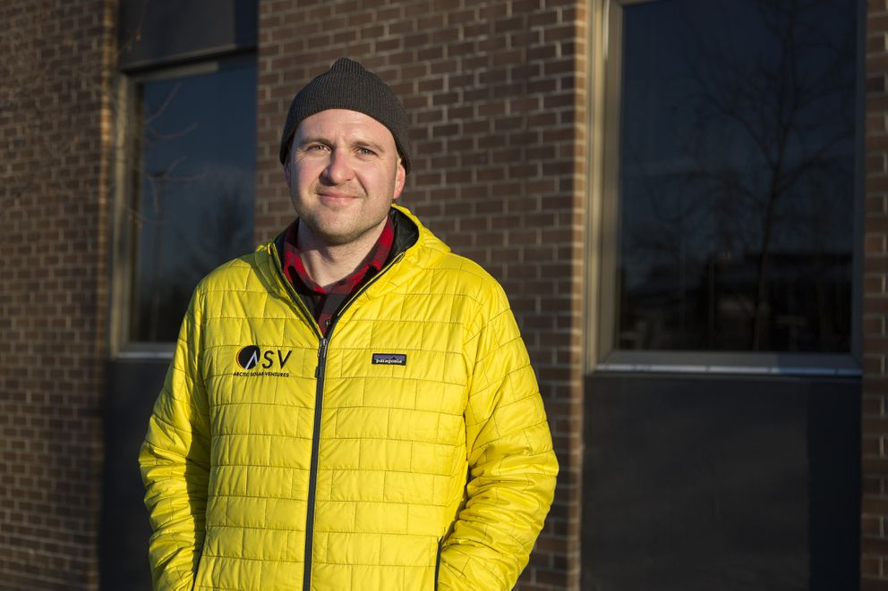 Stephen Trimble, founder and CEO of Arctic Solar Ventures, poses for a portrait in front of the building with his latest solar installation on Saturday, March 20, 2017, in downtown Anchorage. The solar panels were operational on the winter solstice and will provide 15 percent of the 20,000 square-foot commercial office spaces's annual energy usage. (Rugile Kaladyte / Alaska Dispatch News)