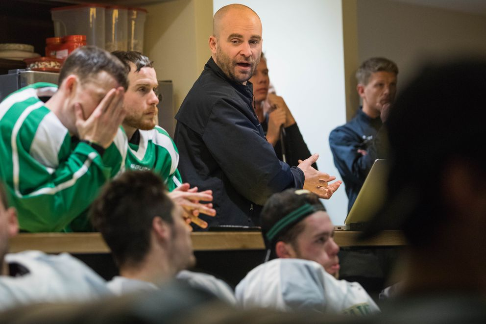 UAA men's hockey assistant coach Louis Mass goes over a play in the team's locker room at the Wells Fargo Sports Complex. (Loren Holmes / Alaska Dispatch News)