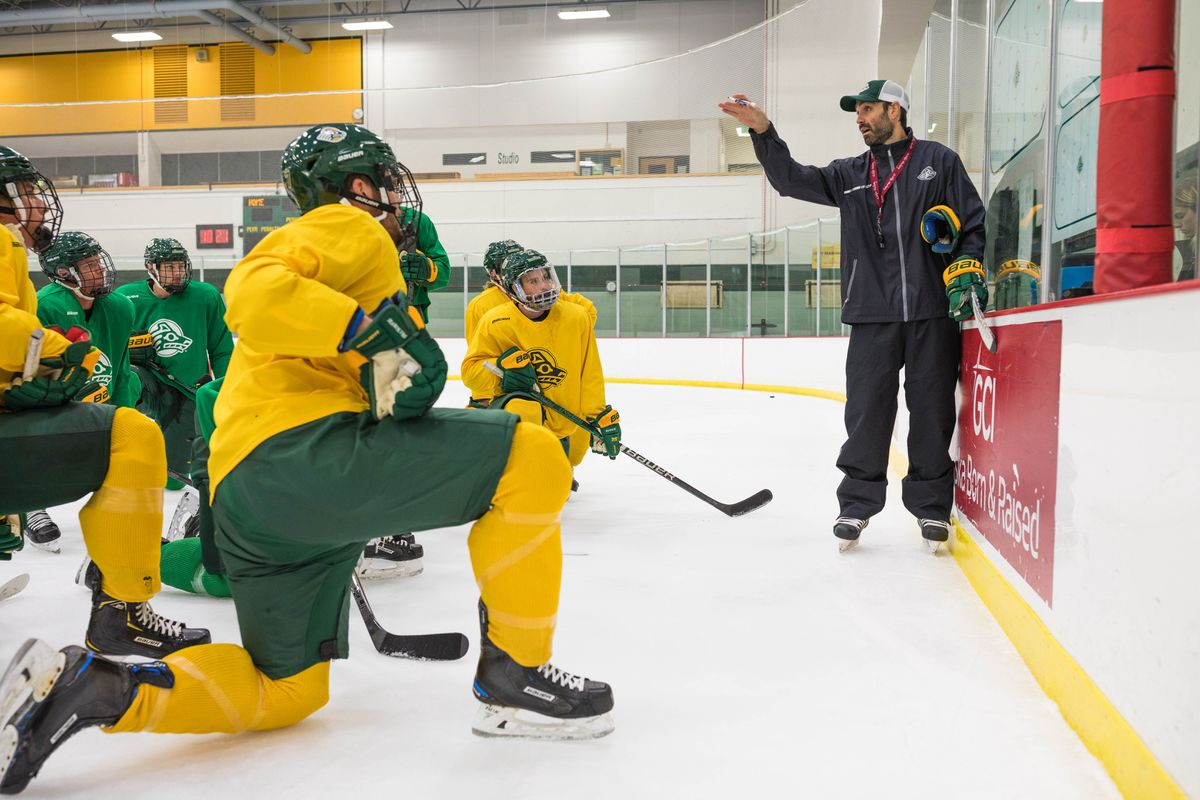 Matt Curley, shown here running a UAA practice last season, is in New York this week to choose players for the USA Hockey team he will coach at an international tournament next month in Germany. (Loren Holmes / ADN)