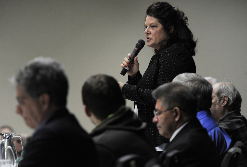 """Rebecca Logan answers a question as seven mayoral candidates participated in the Anchorage Chamber of Commerce's """"Make It Monday """" forum at the Dena'ina Center on Monday, Feb. 26, 2018. (Bill Roth / ADN)"""