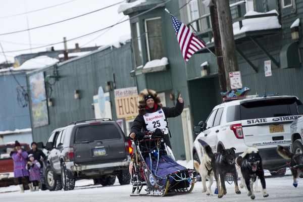 Aaron Burmeister, of Nome, gives a thumbs up as he arrives on Front Street in Nome during the Iditarod Trail Sled Dog Race on March 18, 2020, in Nome. (Marc Lester / ADN)
