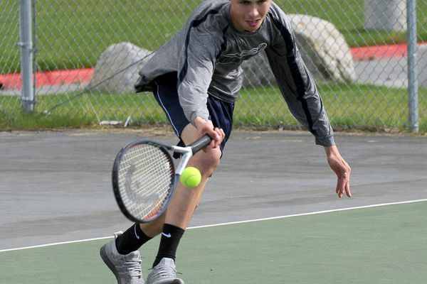 Griffin Marson, of Eagle River High, returns the tennis ball against Jack Perkins, of South High, at Begich Middle School in Anchorage, AK on Thursday, August 16, 2018. Perkins defeated Griffin 10-7 in a tiebreaker. (Bob Hallinen / ADN)