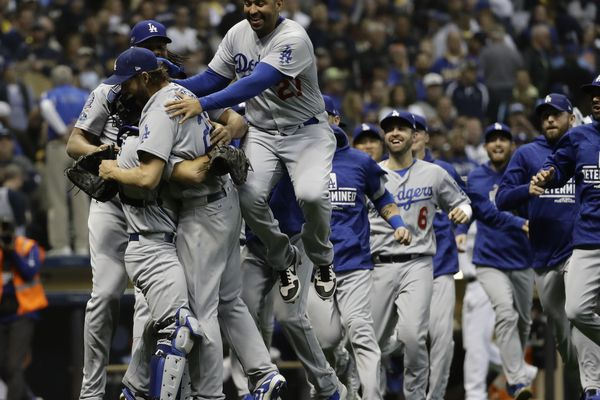 The Los Angeles Dodgers celebrate after Game 7 of the National League Championship Series baseball game Saturday, Oct. 20, 2018, in Milwaukee. The Dodgers won 5-1 to win the series. (AP Photo/Matt Slocum)