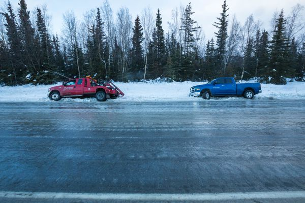 AK Towing tow truck driver Darius Manley got stuck himself while responding to a call from motorist Hemant Sisodia on Hillside Dr. on Thursday morning, Jan. 26, 2017. Freezing rain made roads extremely icy during the morning commute. (Loren Holmes / Alaska Dispatch News)