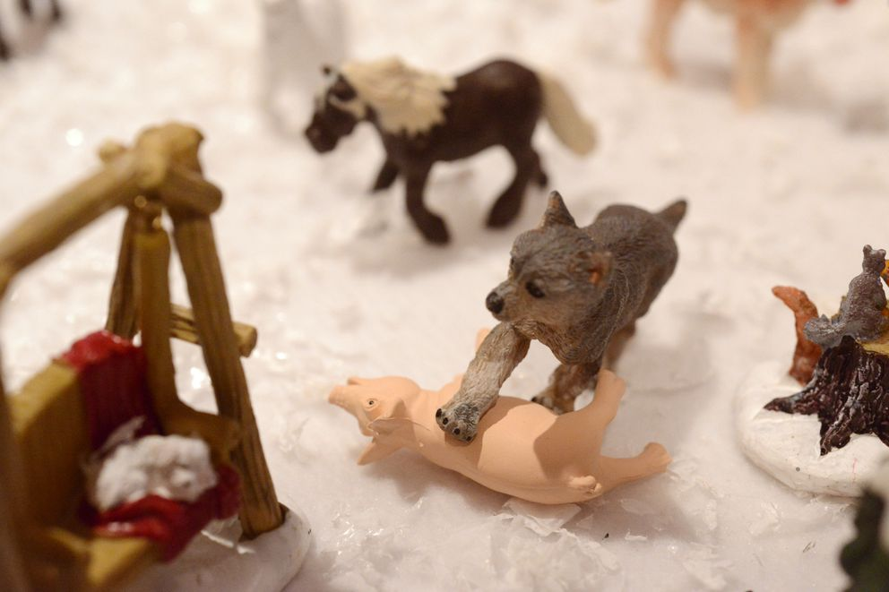 Nate Baer's daughter, Gracie, depicted a wilder scene in a farmyard drama with a wolf taking down a pig. (Anne Raup / ADN)