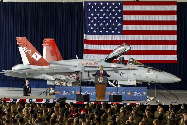 With a F/A-18 Hornet behind him, President Donald Trump speaks to Marines at Marine Corps Air Station Miramar in San Diego, Calif. on March 13, 2018. (Hayne Palmour IV/San Diego Union-Tribune/TNS)