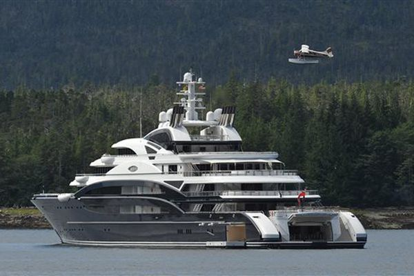 A float plane flies over the super yacht Serene during take off in Ketchikan, Alaska Friday morning. Work began on the 493-foot 3-inch yacht in 2007 by Italian shipbuilder Fincantieri. The ship has a crew of 52 and room for 24 guests. The seven deck vessel has landing capabilities for two helicopters and for a submarine and a sea water pool. (AP Photo/Ketchikan Daily News, Hall Anderson)