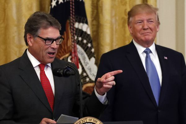 President Donald Trump listens as Energy Secretary Rick Perry speaks during an event about the environment in the East Room of the White House, Monday, July 8, 2019, in Washington. (AP Photo/Alex Brandon)