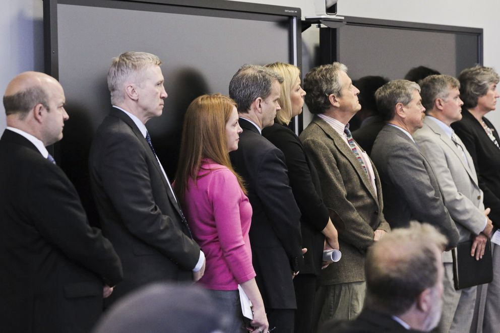 Alaska commissioners and others listen as Gov. Bill Walker discusses the state's budget situation at a press conference in Anchorage on Wednesday. (Loren Holmes / Alaska Dispatch News)