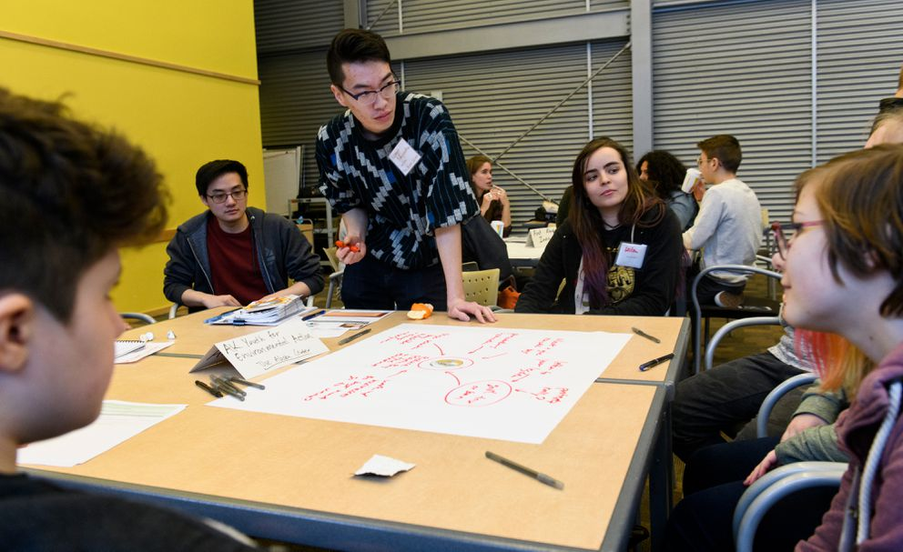 Kengo Nagaoka, youth civic engagement coordinator for Alaska Center, leads a discussion. Dozens of teens and young adults gathered for the first Youth Empowerment Party, held at the BP Energy Center on January 21, 2019. (Marc Lester / ADN)