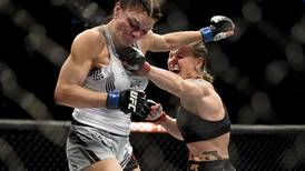 World champ brutalizes Alaska fighter Lauren Murphy in UFC title bout