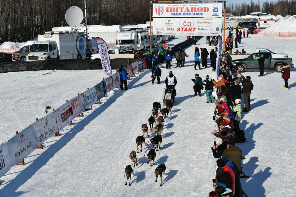 Pete Kaiser begins his 2021 Iditarod Trail Sled Dog Race in Deshka Landing, Sunday, March 7, 2021. (Marc Lester / ADN)