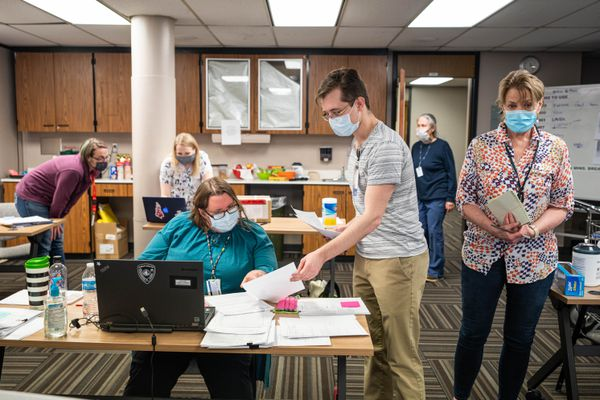 Nurses from the Anchorage Health Department and Anchorage School District work on the COVID-19 contact investigations and monitoring team on Thursday, April 16, 2020 in a conference room at the health department in downtown Anchorage. (Loren Holmes / ADN)