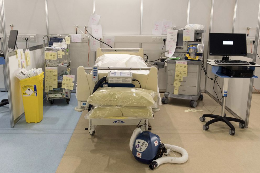 In this photo taken on Tuesday, March 31, 2020, medical equipment is labelled and prepared for use at the ExCel centre which is being made into a temporary hospital, in London. The new hospital - the NHS Nightingale, will comprise two wards, each of 2,000 people, to help tackle coronavirus. (Stefan Rousseau/Pool Photo via AP)