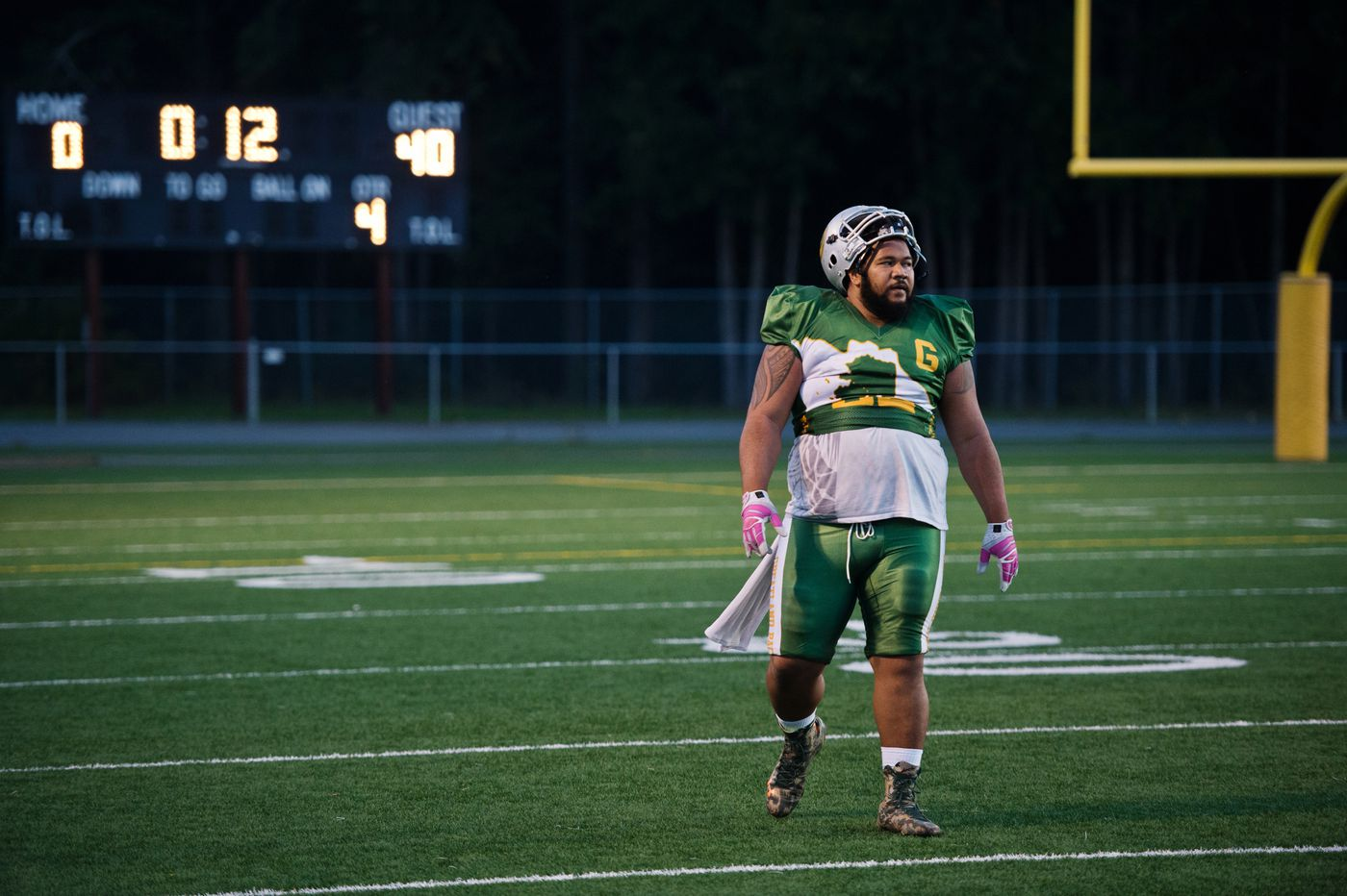 With the game winding down in a lopsided loss against the Anchorage Cowboys, King Matavao of the Greatland Packers heads to the sidelines on Sept. 3, 2018. (Marc Lester / ADN)