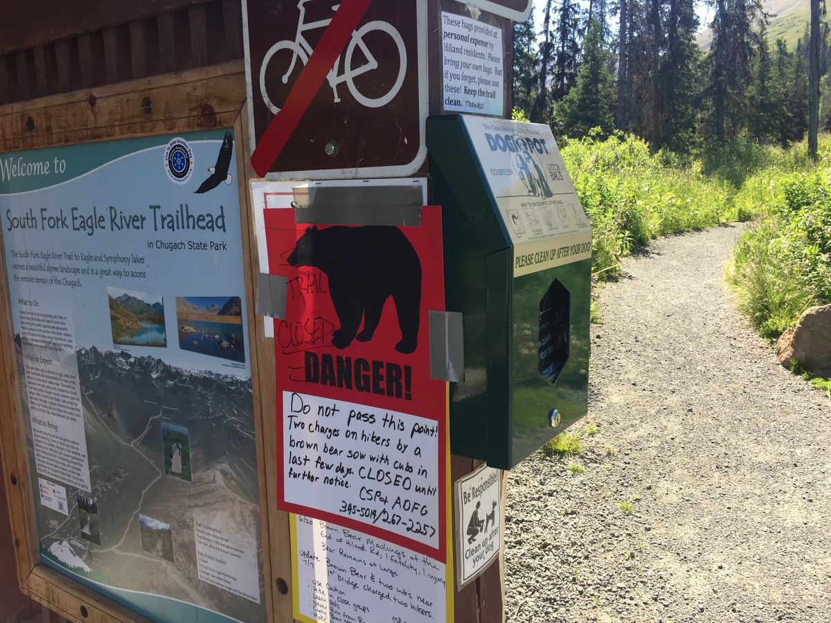 A sign warns hikers of a trail closure due to bear activity at the South Fork Eagle River trailhead on Thursday. (Matt Tunseth / Alaska Star)