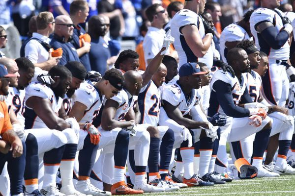 Sep 24, 2017; Orchard Park, NY, USA; Denver Broncos free safety Bradley Roby (29) raises his arm as other players kneel during the playing of the national anthem at New Era Field. Mark Konezny-USA TODAY Sports