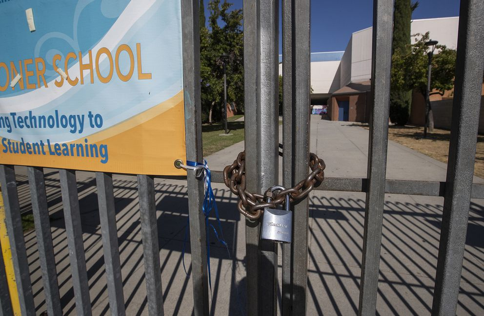A gate in front of Los Angeles High School in Los Angeles is locked on July 13, 2020. (Mel Melcon/Los Angeles Times/TNS)