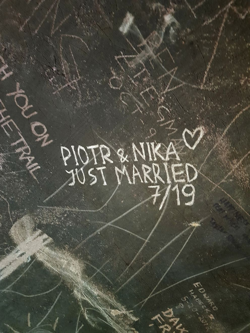 This undated photo provided by Piotr Markielau shows what he and his wife, Veranika Nikonova, scratched on an abandoned bus in the Alaska wilderness shortly before she died on July 25, 2019, following her struggle to cross the Teklanika River. Markielau said he frantically tried but failed to save his wife as she struggled to cross the river near a bus in the Alaska wilderness made famous by the movie 'Into the Wild. ' (Piotr Markielau via AP)