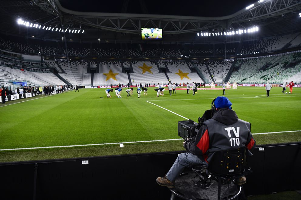 A view of the empty Juventus stadium, as a measure against coronavirus contagion, prior to the Serie A soccer match between Juventus and Inter, in Turin, Italy, Sunday, March 8, 2020. Serie A played on Sunday despite calls from Italy's sports minister and players' association president to suspend the games in Italy's top soccer division. (Marco Alpozzi/LaPresse via AP)