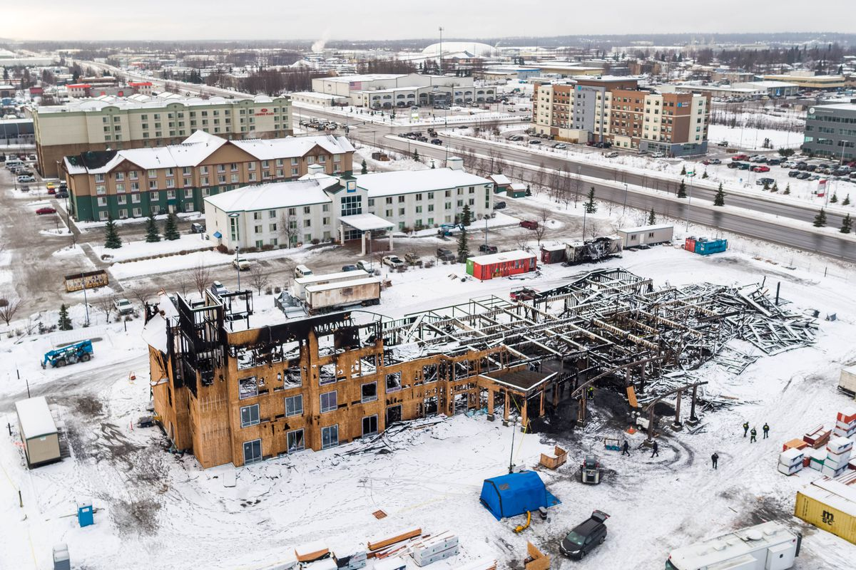 A response team from the Bureau of Alcohol, Tobacco, Firearms and Explosives investigates the scene of a fire at the Courtyard by Marriott construction site Wednesday, Jan. 30, 2019. (Loren Holmes / ADN)