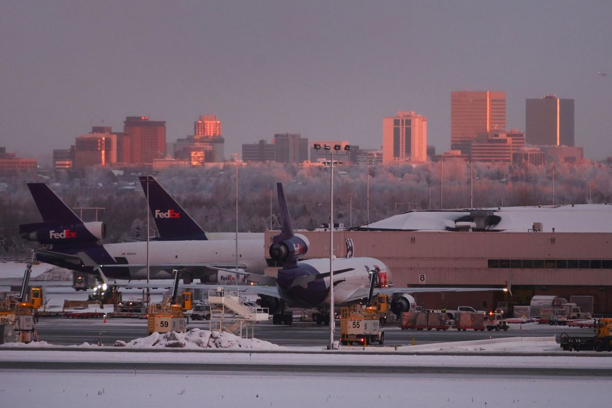 FedEx cargo jets parked at the FedEx Express Anchorage Hub at Ted Stevens Anchorage International Airport on Tuesday, Dec. 8, 2020. (Bill Roth / ADN)