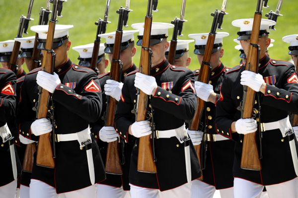 Members of the Marine Corps march in formation during a wreath-laying ceremony at the Tomb of the Unknown Soldier in observance of Memorial Day, Monday, May 27, 2019, at Arlington National Cemetery in Arlington, Va. (AP Photo/Patrick Semansky)