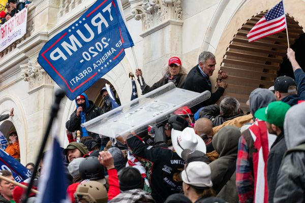 Demonstrators steal a Metropolitan Police riot shield while attempting to enter the U.S. Capitol building during a protest in Washington, D.C., on Jan. 6, 2021. MUST CREDIT: Bloomberg photo by Eric Lee.