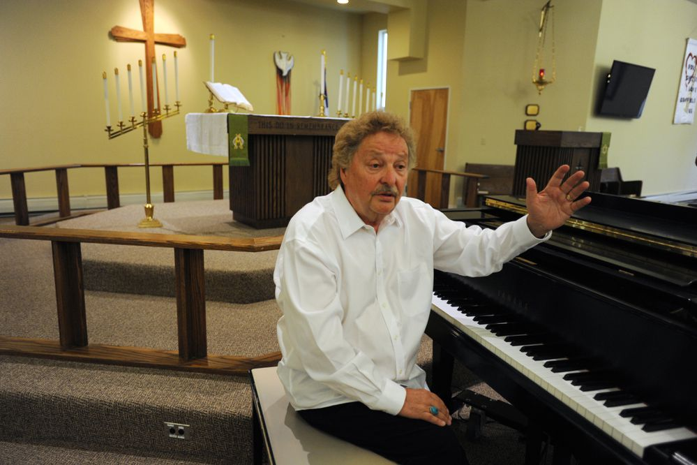 Dave Anderson describes being rescued after the plane he was riding on crashed into the Bering Sea 25 years ago. Anderson was preparing to perform a music concert with Roger Walck at St. John Lutheran Church in Palmer on Sunday, Aug. 5, 2018. (Bill Roth / ADN)