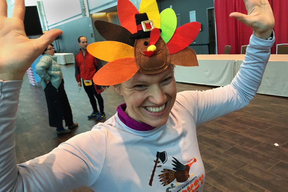 Kristin Thompson celebrates finishing the Skinny Raven Turkey Trot at the Dena'ina Center in downtown Anchorage on Thanksgiving Day, November 26, 2015. Thompson ran with her entire family of seven. When she was asked if her costume was homemade, Thompson laughed that she bought it on Amazon. (Scott Jensen / ADN archive 2015)