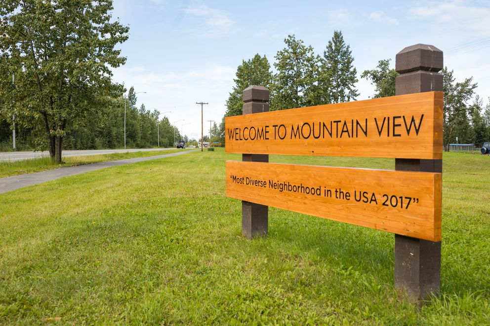 """The cityrecently replaced oldsigns that had proclaimed Mountain View """"USA Neighborhood of the Year 1989""""with new ones recognizing its diversity. (Loren Holmes / Alaska Dispatch News)"""
