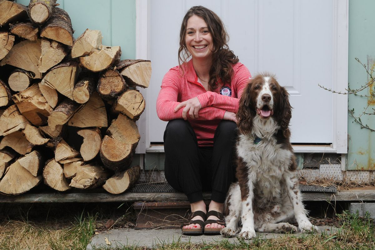 Two-time Olympic curler Jessica Schultz at her Anchorage home with 11-year-old Springer spaniel Diesel on Thursday. Schultz has recovered from a month-long battle with COVID-19 after being infected while traveling during the onset of the pandemic. (Bill Roth / ADN)