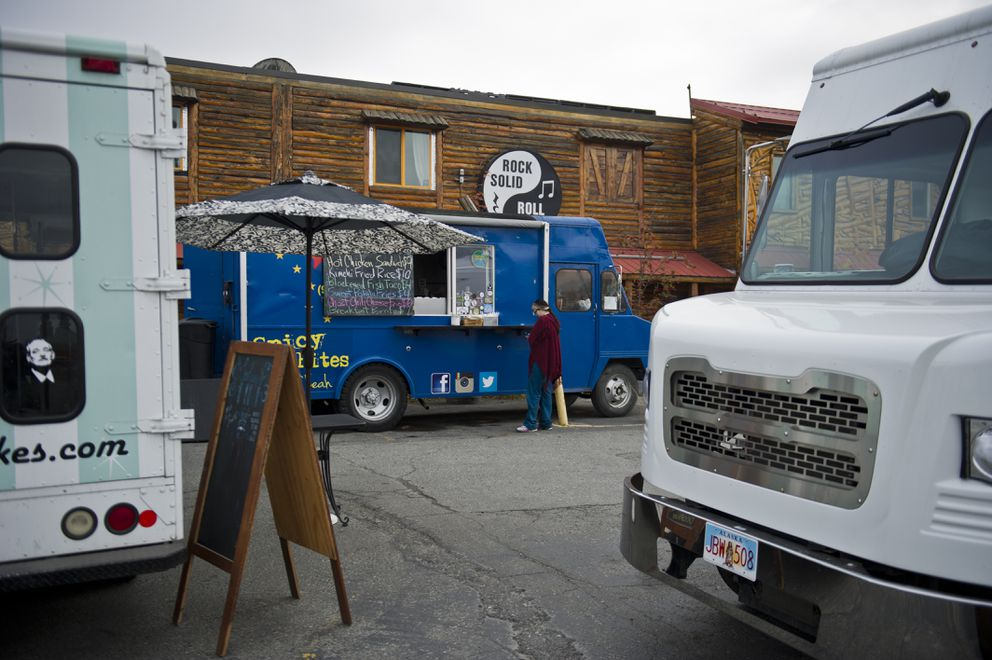 Food trucks gather in the Chilkoot Charlie's parking lot for the Spenard Food Truck Carnival. (Marc Lester / Alaska Dispatch News)