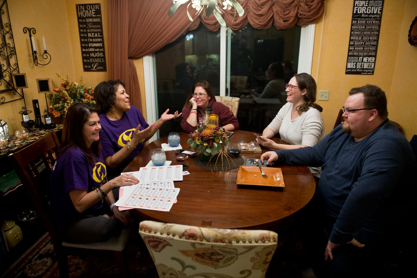 Five Alaskans who survived the mass shooting at the Route 91 Harvest Festival in Las Vegas gathered for dinner on December 1, 2017, in Anchorage. From left are Jaimie Farrell, Michele McKean, Chris Holman, Chrissy Braniger and Erik Ross. (Marc Lester / ADN)