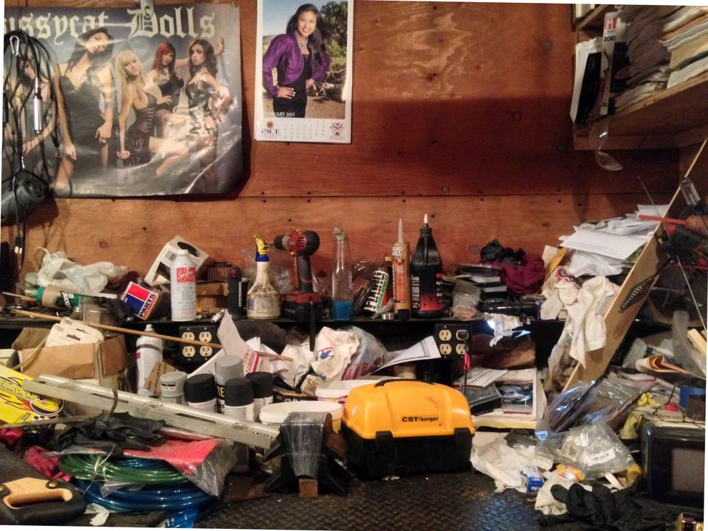 A cluttered shelf inside of Rudy Hamilton's workshop fashioned from a C-119 cargo plane. (Laurel Andrews / Alaska Dispatch News)