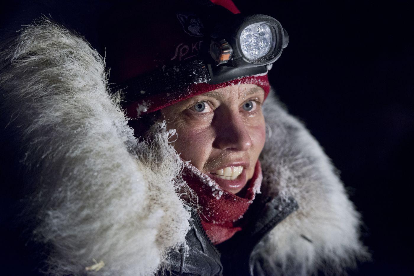 Aliy Zirkle arrives in Unalakleet. Brent Sass, Dallas Seavey and Aliy Zirkle were the first mushers to reach Unalakleet in the Iditarod Trail Sled Dog Race on Sunday, March 13, 2016.