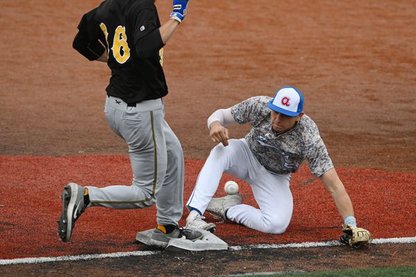 Bucs baserunner Matt Erickson makes it safely to first base as Pilots Ethan Mann attempts catch a throw during the Bucs' 5-2 victory over the Anchorage Glacier Pilots at Mulcahy Stadium on Sunday, June 20, 2021. (Bill Roth / ADN)