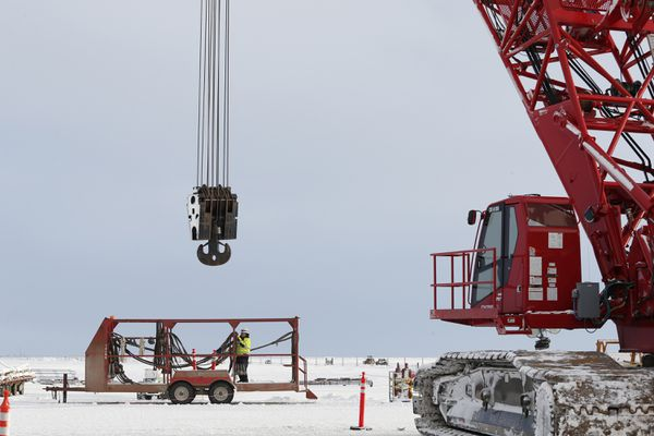 A crane stands by for module and facility installation on the GMT-1 drilling pad. (Photo by Judy Patrick / ConocoPhillips)