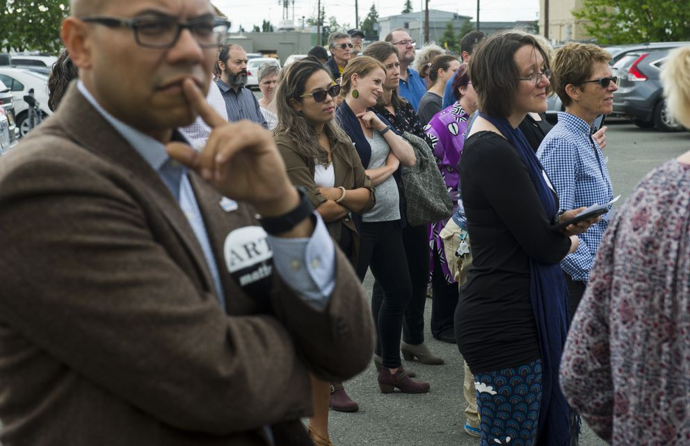 Artists and supporters of the Alaska State Council on the Arts gathered outside its offices in Anchorage to say farewell on Monday afternoon, July 15, 2019. The agency closed Monday due to its loss of funding by veto by Gov. Mike Dunleavy. (Marc Lester / ADN)