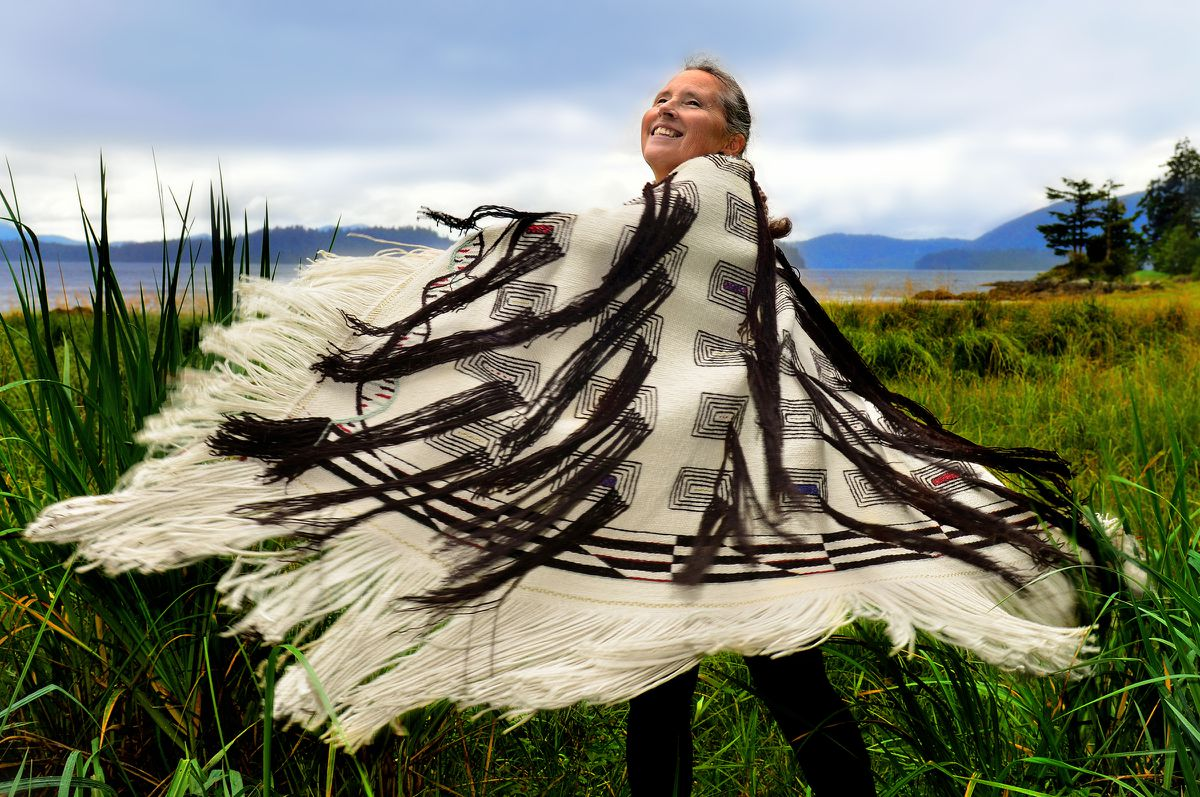 Teri Rofkar dances in one of her Raven's Tail robes. (Courtesy Tom Pitch / NEA)
