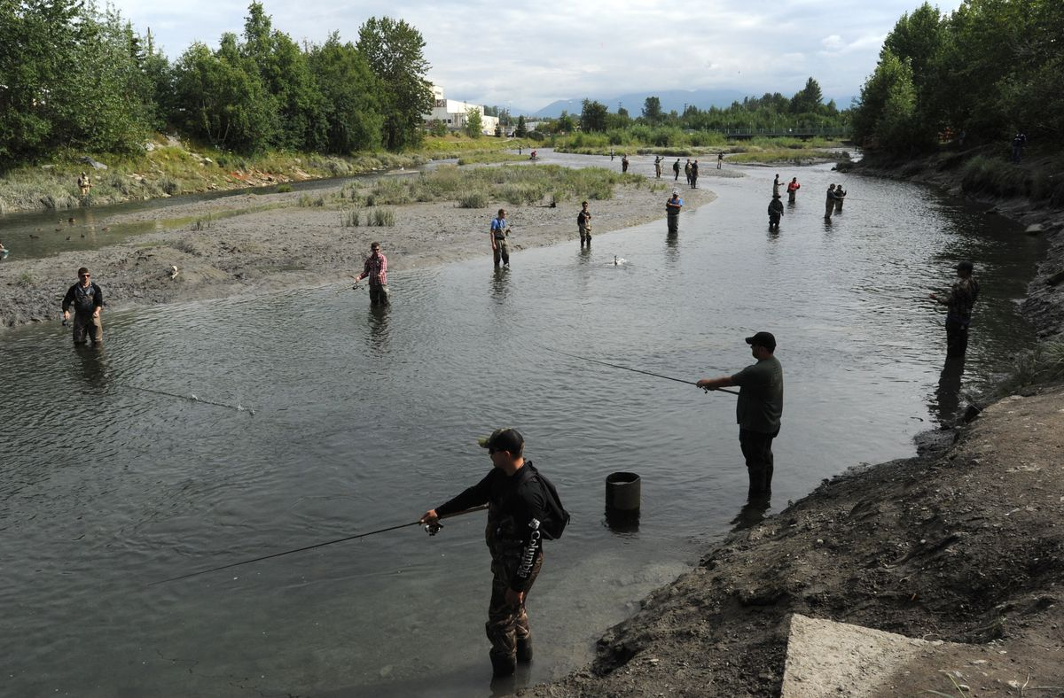 Anglers try their luck fishing for coho salmon during an incoming tide at Ship Creek near downtown Anchorage on July 30, 2017. (Bill Roth / ADN archive)