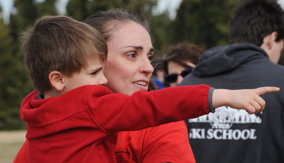 Olin 'Turbo ' Ahonen, 4, shares a moment with his mother Mary Ahonen before the start of the Olin Turbo and Mom family fun run at Service High School on Mother's Day. (Bill Roth / ADN)
