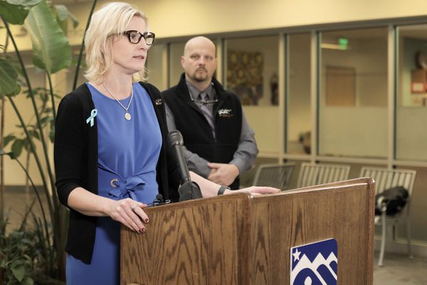 Anchorage School District superintendent Deena Bishop and teacher's union president Tom Klaameyer announce that they have reached a tentative agreement Wednesday, Nov. 15, 2017 at the ASD Education Center. (Loren Holmes / Alaska Dispatch News)