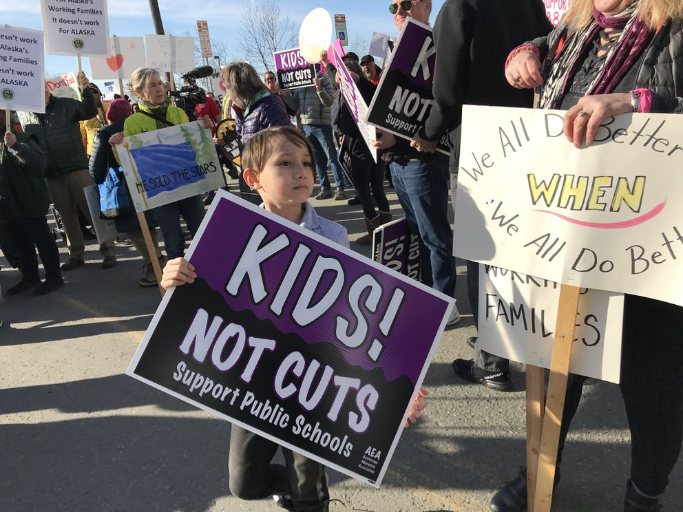 Able Freeman, 7, a first grade student at Lake Hood Elementary joined protesters outside 49th State Brewing Company March 26, 2019. Gov. Mike Dunleavy is having an event organized by Americans for Prosperity at the brewery. (Bill Roth / ADN)