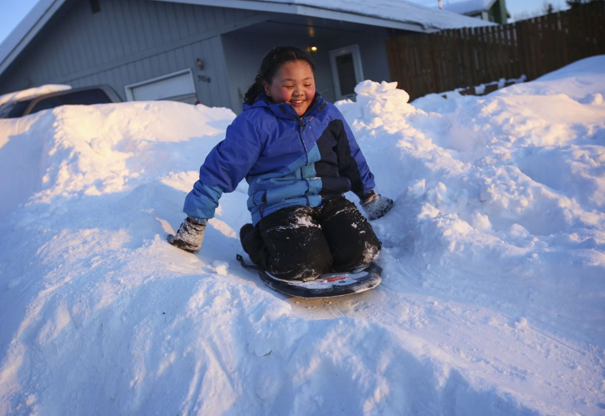 Anchorage girl turns snow pile into quinzee and three-run sledding hill