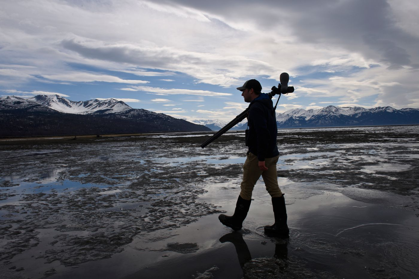 Anchorage birder Sulli Gibson looks for birds on the Anchorage Coastal Wildlife Refuge on April 18, 2021. (Marc Lester / ADN)