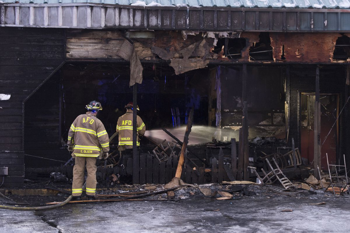 Anchorage firefighters douse hotspots from a fire that destroyed Yakitori Sushi House on Tudor Road on Monday. (Marc Lester / ADN)